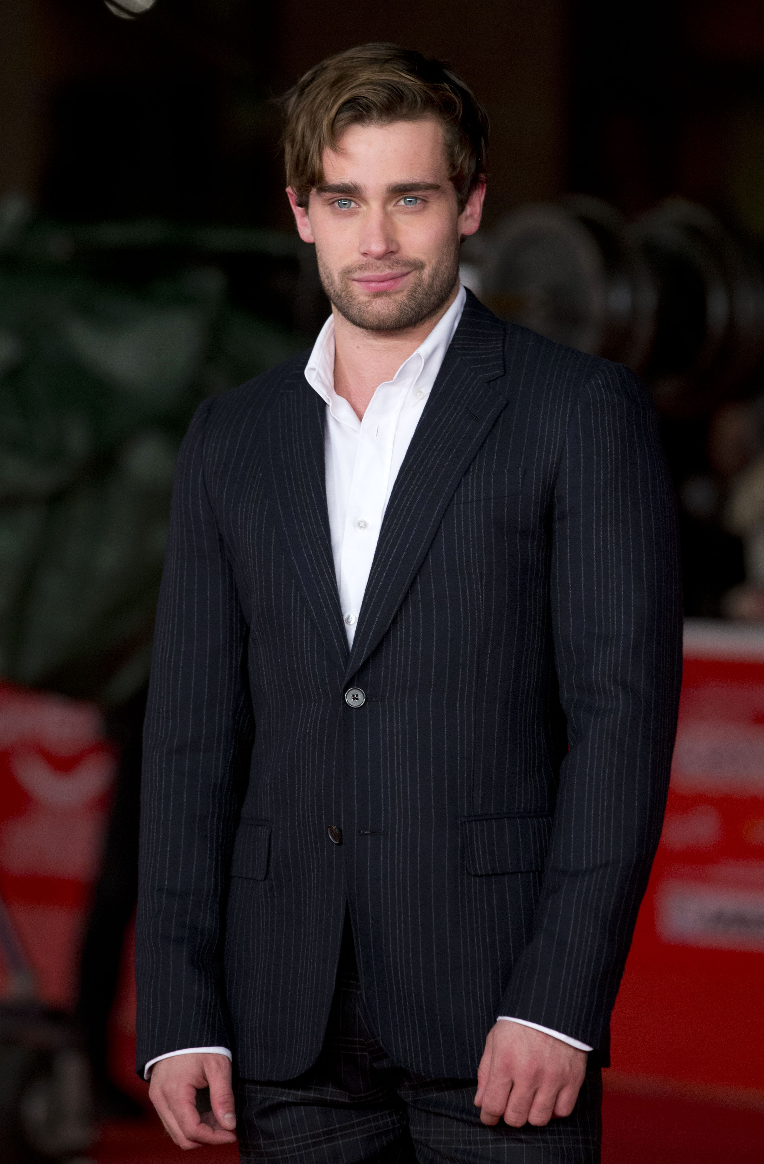 Actor Christian Cooke poses during the red carpet of the movie 'Romeo and Juliet', at the 8th edition of the Rome International Film Festival, in Rome, Monday, Nov. 11, 2013. (AP Photo/Andrew Medichini)